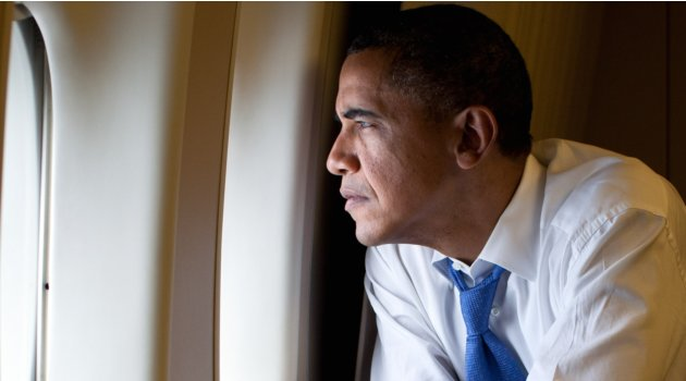 President Barack Obama looks out a window of Air Force One during the flight from Canberra to Darwin, Australia, Nov. 17, 2011. (Official White House Photo by Pete Souza) This official White House photograph is being made available only for publication by news organizations and/or for personal use printing by the subject(s) of the photograph. The photograph may not be manipulated in any way and may not be used in commercial or political materials, advertisements, emails, products, promotions that in any way suggests approval or endorsement of the President, the First Family, or the White House.